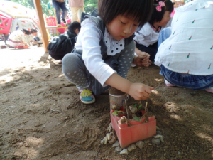 Chinese student playing in the sand